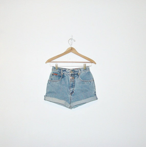 highwaist shorts . grungy denim shorts . triangles and buttons on back . vintage 80s . xs-s . at montanasnowvintage