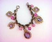 Reserved for Alda...Reserved   ...Reserved...        Vintage German Pink and Purple Glass Charm Bracelet