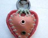 orange and red two-eyelet ringtop heart
