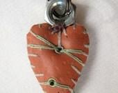 orange and black three-eyelet ringtop heart