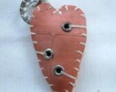 elongated orange three-eyelet  heart