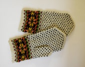 Hand knitted warm wool mittens , gloves patterned white snow