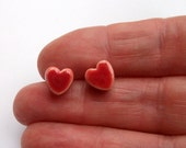 Tiny red heart ceramic stud earrings, sterling silver posts and scrolls
