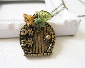 Antique Brass Fairy Door Necklace. gate pendant necklce