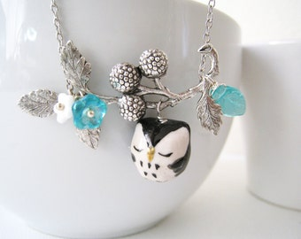 Owl Necklace. black sleepy owl with antique silver berry branch