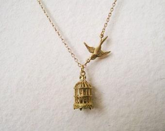Gold Bird Cage Necklace. bird necklace. tiny birdcage necklace. birdcage and flying bird necklace