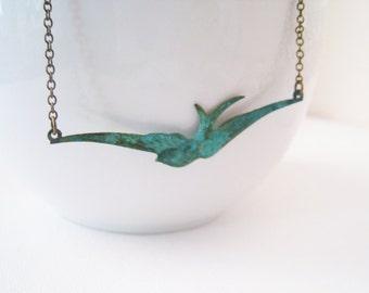 Flying Bird Necklace. verdigris patina soaring bird in antique brass chain