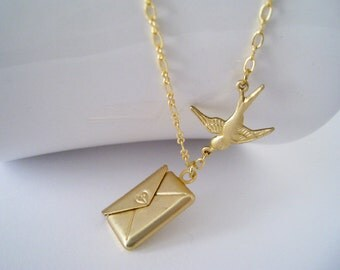 Gold Envelope Locket Necklace. matte gold envelope with flying sparrow