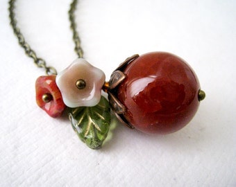 Red Berry Necklace. agate gem and flowers in antique brass chain