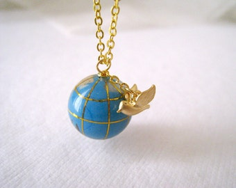 Global Traveler. Matte Gold Bird Charm with Globe Bead Necklace