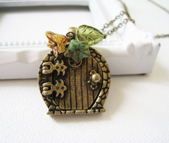 Antique Brass Fairy Door Necklace. gate pendant necklce
