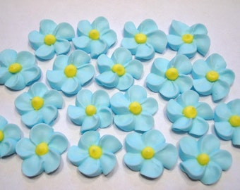 LOT of 100 forget me not royal icing flowers
