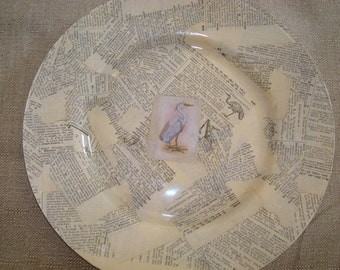 Wonerful Decoupaged  Plate with Crane picture and Antique Dictionary pages.