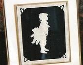 Old fashioned scherenschnitte paper-cutting boy