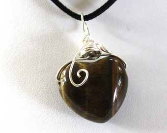 Large heart shaped tiger eye stone wire wrapped in silver wire on a black suede necklace 18 inches long