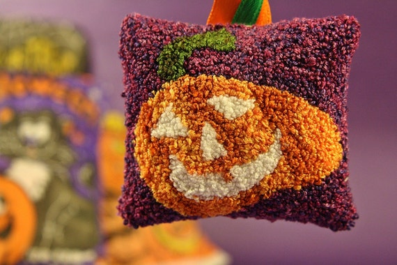 Jack O Lantern Halloween Home Decor. Glow in the Dark Sachet. Pumpkin Ornament. Punchneedle Embroidery. Orange, Purple, Green.