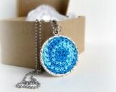 Blue Swirl Circle Pendant. Handmade crocheted cotton lace pendant necklace