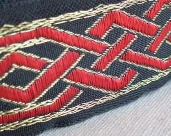 Celtic Dragon Knot Jacquard ribbon trim RED and GOLD on BLACK .