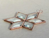 Clear beveled stained glass six-pointed star suncatcher.