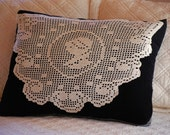 Decorative upcycled silhouette doily pillow