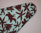 Ironing Board cover is Joel Dewberry and has Chocolate Brown Lilys on Mint.