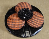 BUTTON FLOWER PIN, Orange and Black Plaid Covered Vintage Buttons, Black Glass Center