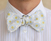 Bow Tie - a white with green and blue patterned mens bow tie