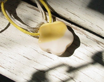 Knotted yellow & white glass pendant necklace with wood bead