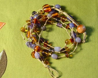 Amber and purple colored glass beaded wrap bracelet