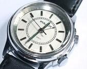 Vintage Russian mechanical alarm wristwatch Poljot from Soviet Union period