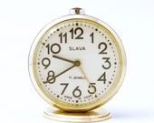 Vintage Russian mechanical alarm clock Slava from Soviet Union period green clock