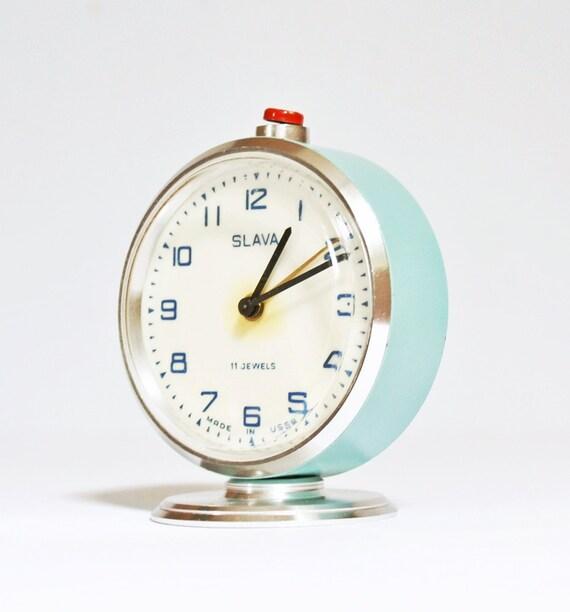 Vintage Russian mechanical alarm clock Slava from Soviet Union period turquoise colour