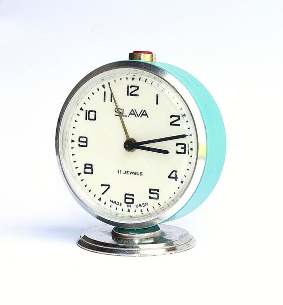 Vintage Russian mechanical alarm clock Slava from Soviet Union period turquoise green clock