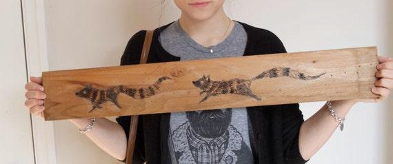 Hand burned wolves on wood