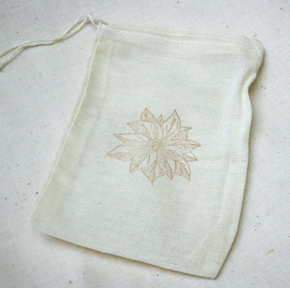 6 muslin drawstring bags 4x6 inches stamped with a poinsettia for the holidays
