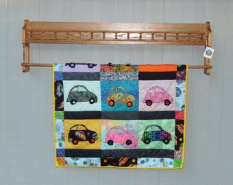 Quilt display with shelf and gallery rail