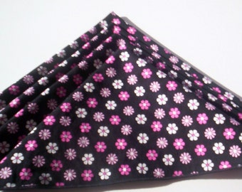 Set Of Four Black Fabric Napkins With Pink And White Flowers