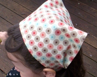 Multi Colored Sprials On Girls Head Scarf