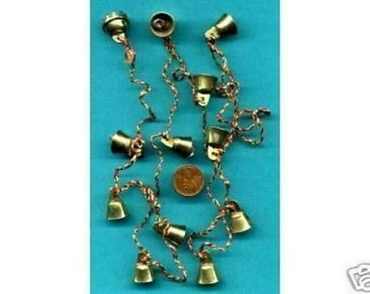 12 small, brass, fairy bells which are 15mm,  belly dance, feng shui