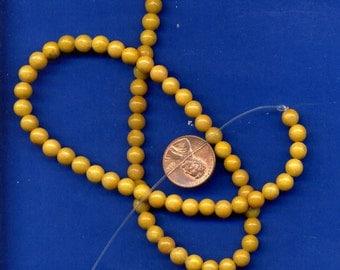 16 Inch Strand of  6mm Yellow Jade Beads