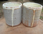 Stoneware ceramic juice cups with shino and pale yellow glaze (set of two)