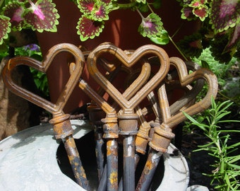 Eight Heart Hose Guides - Cast Iron welded to Steel for the Garden