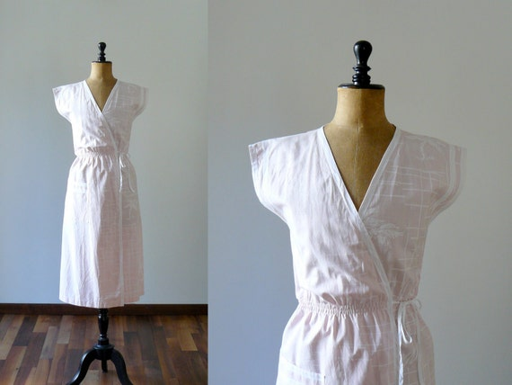 Vintage 1970s light pink wrap cotton dress. palm tree print summer dress