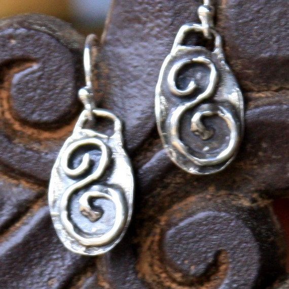 evolve earrings - whispering that message into your ears all day....inspirational and motivational