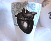 Anatomical heart cut out necklace