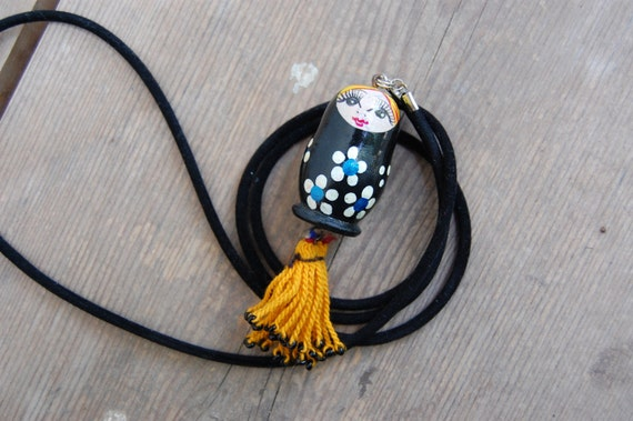 black and yellow russian doll necklace