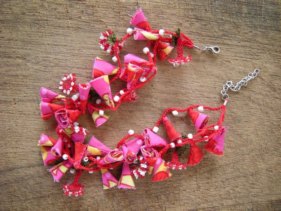 pink and red necklace with flowers