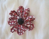 red and white flower pin