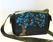 black leather purse with a hand painted tree