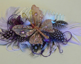 Butterfly Facinator Feather hair comb in lavender and purple feathers